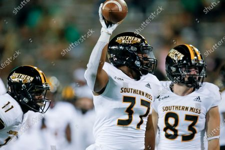 Southern Mississippi linebacker Devin Thomas (37) celebrates after recovering a North Texas fumble during the second half of an NCAA college football game, in Denton, Texas