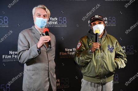 """Musician David Byrne, left, and director Spike Lee introduce """"David Byrne's American Utopia"""" at the Queens Drive-In at the New York Hall of Science during the 58th New York Film Festival, in New York"""