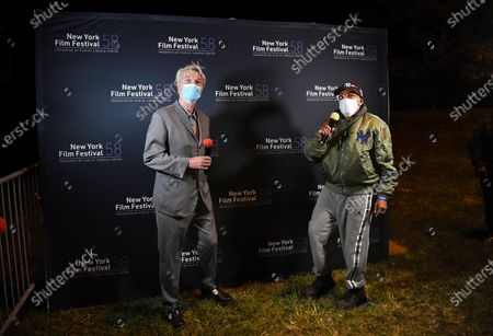 "Musician David Byrne, left, and director Spike Lee introduce ""David Byrne's American Utopia"" at the Queens Drive-In at the New York Hall of Science during the 58th New York Film Festival, in New York"