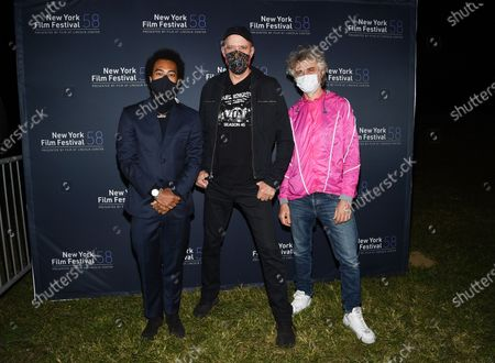 "Musicians Bobby Wooten III, from left, Karl Mansfield and Mauro Refosco attend the ""David Byrne's American Utopia"" film screening at the Queens Drive-In at the New York Hall of Science during the 58th New York Film Festival, in New York"