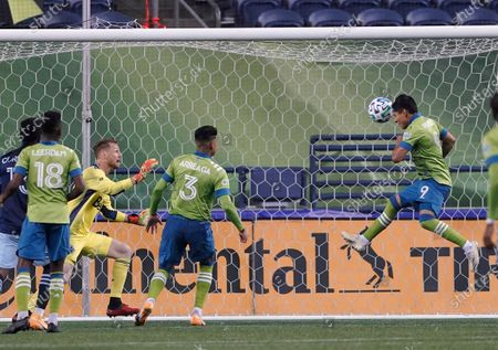 Seattle Sounders forward Raul Ruidiaz (9) scores a goal against Vancouver Whitecaps goalkeeper Bryan Meredith, third from left, during the second half of an MLS soccer match, in Seattle