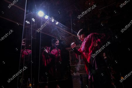 """Flamenco dancer Marina Perez performs behind screens during a flamenco show at the Torres Bermejas """"tablao,"""" or live flamenco venue, in Madrid, Spain, . The passion and drama of live flamenco shows are back on stage in Madrid. But now the performers are behind Perspex screens and keeping their distance from the audience. The Torres Bermejas """"tablao,"""" or live flamenco venue, has reopened its doors to customers after seven months closed due to the COVID-19 pandemic"""