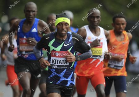 Ethiopia's Shura Kitata, center, races to win the London Marathon in London, England,. second right is Kenya's Eliud Kipchoge who placed eighth