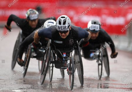 Britain's David Weir competes in the men's elite wheelchair race at the London Marathon in London, England