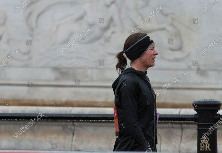 Stock Picture of Britain's Stephanie Twell reacts after having to withdraw from the London Marathon in London, England,. Athletes are competing on a 26.2-mile (42.2-kilometer) closed-loop course consisting of 19.6 clockwise laps around St. James' Park. The traditional course along the River Thames was scrapped because of the coronavirus pandemic and only elite men and women are competing and no spectators are permitted