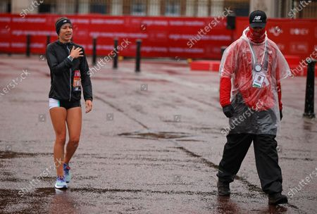 Stock Image of Britain's Stephanie Twell reacts after having to withdraw from the London Marathon in London, England,. Athletes are competing on a 26.2-mile (42.2-kilometer) closed-loop course consisting of 19.6 clockwise laps around St. James' Park. The traditional course along the River Thames was scrapped because of the coronavirus pandemic and only elite men and women are competing and no spectators are permitted