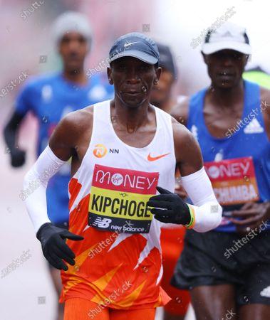 Eliud Kipchoge of Kenya (L) runs in the elite men's race during the London Marathon in London, Britain, 04 October 2020.