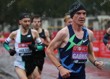 Arne Gabius (R) of Germany in action during elite men's race at the London Marathon in London, Britain, 04 October 2020.