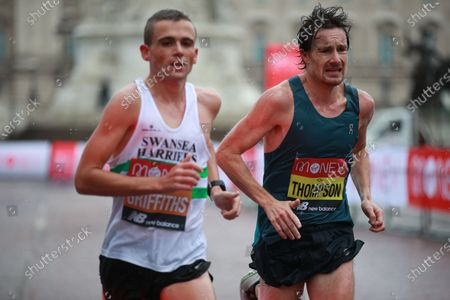 Chris Thompson (R) and Joshua Griffiths (L) of Britain in action during the elite men's race at the London Marathon in London, Britain, 04 October 2020.