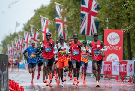 FREE FOR EDITORIAL USE ON BEHALF OF LONDON MARATHON. Eliud Kipchoge (KEN) and the lead runners in the Elite Men's Race on The Mall. The historic elite-only Virgin Money London Marathon taking place on a closed-loop circuit around St James's Park in central London on Sunday 4 October 2020.  Photo: Thomas Lovelock for Virgin Money London Marathon  For further information: media@londonmarathonevents.co.uk
