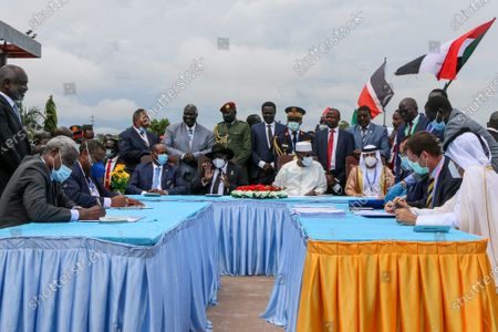 The head of Sudan's sovereign council, Gen. Abdel-Fattah Burhan, seated center-left, President of South Sudan Salva Kiir, seated center, and President of Chad Idriss Deby, seated center-right, attend a ceremony to sign a peace deal between Sudan's transitional authorities and a rebel alliance, in Juba, South Sudan, . Sudan's transitional authorities and a rebel alliance on Saturday signed the peace deal initialed in August that aims to put an end to the country's decades-long civil wars, in a televised ceremony in Juba, South Sudan marking the agreement