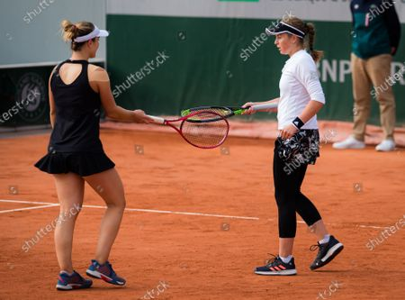 Jelena Ostapenko of Latvia & Gabriela Dabrowski of Canada playing doubles at the 2020 Roland Garros Grand Slam tennis tournament