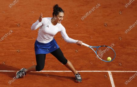 Martina Trevisan of Italy hits a forehand during her fourth round match against Kiki Bertens of the Netherlands during the French Open tennis tournament at Roland Garros in Paris, France, 04 October 2020.