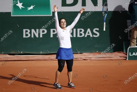Martina Trevisan of Italy celebrates after winning her fourth round match against Kiki Bertens of the Netherlands during the French Open tennis tournament at Roland Garros in Paris, France, 04 October 2020.