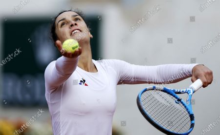 Stock Photo of Martina Trevisan of Italy serves during her 4th round match against Kiki Bertens of the Netherlands during the French Open tennis tournament at Roland Garros in Paris, France, 04 October 2020.