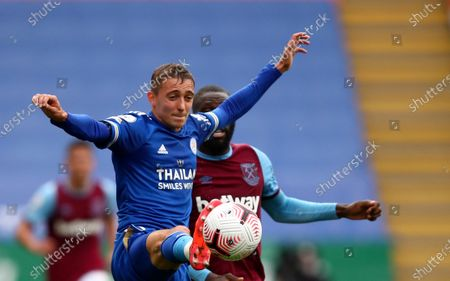 Stock Image of Leicester's Timothy Castagne, left, duels for the ball with West Ham's Arthur Masuaku during the English Premier League soccer match between Leicester City and West Ham United at the King Power Stadium, in Leicester, England