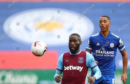 West Ham's Arthur Masuaku, left, duels for the ball with Leicester's Youri Tielemans during the English Premier League soccer match between Leicester City and West Ham United at the King Power Stadium, in Leicester, England
