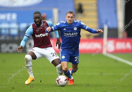 Stock Picture of Leicester's Timothy Castagne, right, duels for the ball with West Ham's Arthur Masuaku during the English Premier League soccer match between Leicester City and West Ham United at the King Power Stadium, in Leicester, England
