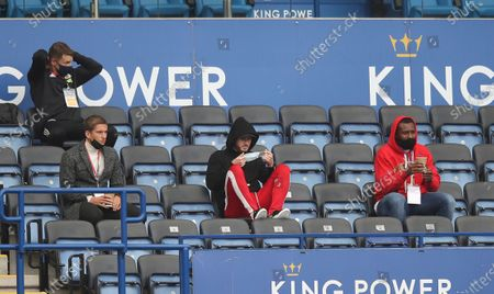 Injured players of Leicester City's Dennis Praet, left, James Maddison,centre, and Wes Morgan in the stands before the English Premier League soccer match between Leicester City and West Ham United at the King Power Stadium, in Leicester, England