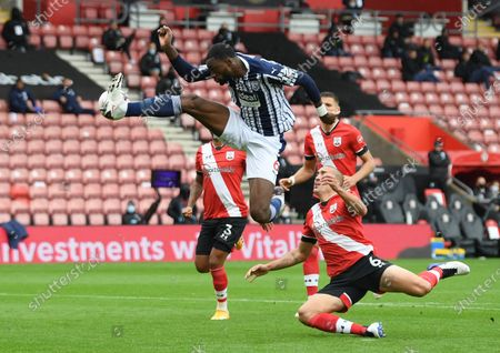 West Bromwich Albion's Semi Ajayi, center, jumps to control the ball in front of Southampton's Oriol Romeu, right, during the English Premier League soccer match between West Bromwich Albion and Southampton at St. Mary's Stadium in Southampton, England