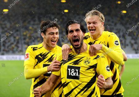 Emre Can (C) of Dortmund celebrates after scoring during a German Bundesliga match between Borussia Dortmund and SC Freiburg in Dortmund, Germany, Oct. 3, 2020.