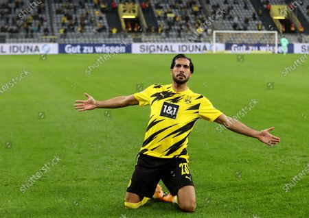 Emre Can of Dortmund celebrates after scoring during a German Bundesliga match between Borussia Dortmund and SC Freiburg in Dortmund, Germany, Oct. 3, 2020.