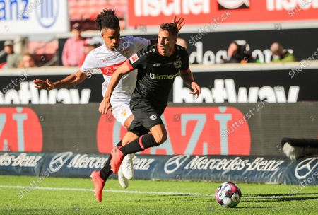 Santiago Arias (R) of Leverkusen vies with Daniel Didavi of Stuttgart during a German Bundesliga match between VfB Stuttgart and Bayer 04 Leverkusen in Stuttgart, Germany, Oct. 3, 2020.