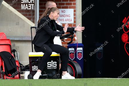 Stock Image of Manchester United Women Manager Casey Stoney gestures during the FA Women's Super League match between Manchester United Women and Brighton and Hove Albion Women at Leigh Sports Village, Leigh