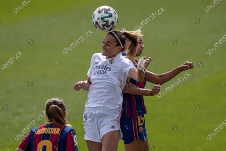 Swedish player Kosovare Asllani (C), of Real Madrid women's soccer team, vies for the ball with Leila Ouahabi, of FC Barcelona women's soccer team during a Spanish women's soccer league soccer match at Valdebebas sport complex, in Madrid, Spain, 04 October 2020.