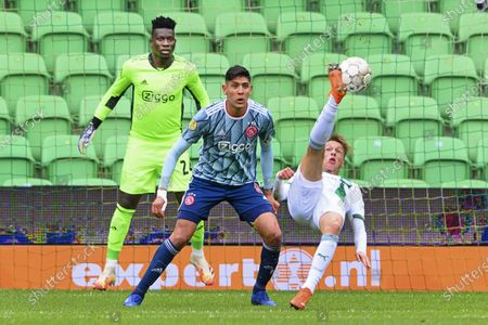 (L-R) Ajax keeper Andre Onana, Edson Alvarez of Ajax, Remco Balk of Groningen in action during the Dutch Eredivisie soccer match between FC Groningen and Ajax in the Hitachi Capital Mobility stadium in Groningen, The Netherlands, 04 October 2020.