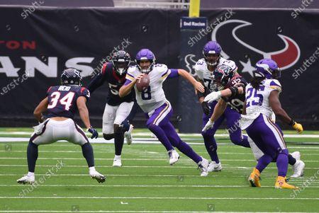Stock Image of Minnesota Vikings quarterback Kirk Cousins (8) runs from Houston Texans cornerback John Reid (34) during the first half of an NFL football game, in Houston