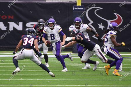Minnesota Vikings quarterback Kirk Cousins (8) runs from Houston Texans cornerback John Reid (34) during the first half of an NFL football game, in Houston