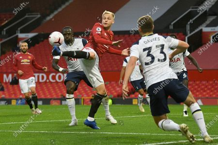 Stock Photo of Manchester United's Timothy Fosu-Mensah, center, reaches for the ball during the English Premier League soccer match between Manchester United and Tottenham Hotspur at Old Trafford in Manchester, England