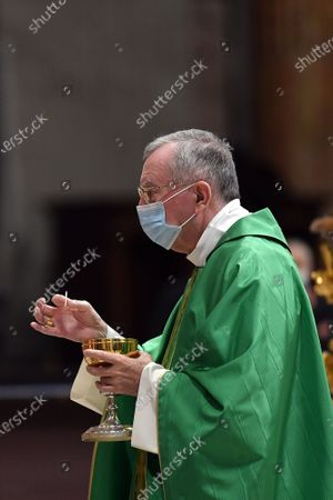 The Vatican Secretary of State, Cardinal Pietro Parolin, celebrates a Mass for the new Pontifical Swiss Guards in St. Peter's Basilica. The Cardinal wears a mask due to the pandemic caused by the Covid-19 virus