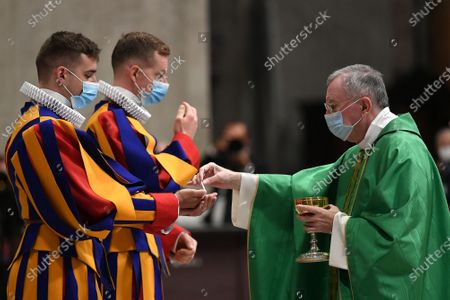 The Vatican Secretary of State, Cardinal Pietro Parolin, celebrates a mass for the new Pontifical Swiss Guards in St. Peter's Basilica. The Cardinal and the Swiss Guards are wearing the mask due to the pandemic caused by the Covid-19 virus
