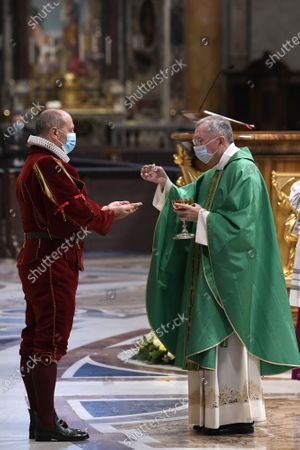 The Vatican Secretary of State, Cardinal Pietro Parolin, celebrates a mass for the new Pontifical Swiss Guards in St. Peter's Basilica. Cardinal and Commander Christoph Graf wear masks due to the pandemic caused by the Covid-19 virus
