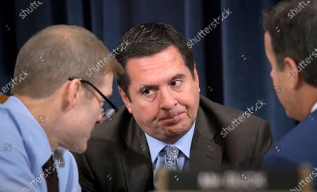 Rep. Devin Nunes, center, R-Calif., the ranking member of the House Intelligence Committee; Rep. Jim Jordan, left, R-Ohio; and Rep. John Ratcliffe, R-Texas, talk during a break as the House Judiciary Committee considers the investigative findings in the impeachment inquiry against President Donald Trump, on Capitol Hill in Washington. Nunes represents California's 22nd District in the Central Valley. California's tarnished Republican Party is hoping to rebound in a handful of U.S. House races but its candidates must overcome widespread loathing for President Donald Trump and voting trends that have made the nation's most populous state an exemplar of Democratic strength