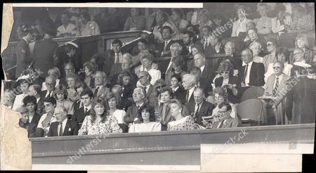 Sarah Duchess Of York - 1988 Who's Who In The Royal Box At Centre Court Last Wednesday. Front Row From The Left- Lady Annabel Goldsmith; Prince Michael Of Kent And Prince Michael; Mrs.penelope Wrong Wife Of The Administrator Of London's Barbican Arts Centre; The Duchess Of Gloucester; Buzzer Hadingham; The Duchess Of York; Mrs.susan Greenall Whose Husband Peter Owns A Ski-ing Chalet In Klosters Where The Duchess Is A Regular Guest; Queen Noor Of Jordan; Philippe Cartrier President Of The International Tennis Federation. Second Row- The Countess Harewood Wife Of Earl Harewood The Queen's Cousin; The Israeli Ambassador Yehuda Avner; Mrs.herbert Walker Wife Of The High Commisioner Of Jamaica; The Spanish Ambassador Puig De La Bellacasa And Mme De La Bellacasa; The Swiss Ambassador Francois Pictet And Mme Pictet; Admiral Sir David Hallifax Governor Of Windsor Castle. Third Row- General Sir Charles Huxtable The Army's Quartermaster General And Lady Huxtable; Admiral Sir Richard Fitch The Second Sea Lord And Lady Fitch; The Hon. Mrs.vivian Baring Lady-in-waiting To The Princes Of Wales; Lady Rose Baring Extra Woman Of The Bed Chamber To The Queen; Lady Wolfson; Gordon Jorgensen President Of The Lawn Tennis Association And Mrs.presley. Fourth Row- John Warr President Of The Mcc And Mrs.warr; John Burgess President Of The Rugby Football Union; Simon Dyer Director General Of The Aa; Sir John Knott Former Minister Of Defence And Chairman Of Lazards Merchant Bank; Schoolboy Edward Bennett-coles; Martin Naughton Chairman Of Glen Dimplex Electrical Company And Mrs.naughton; Stanley Behrens. Fifth Row- Jonathan Myerberg Chairman Of The Mortgage Corporation And Mrs.myerberg; Mrs.a Waterlow; Tony Ward President Of Queen's Club; Christopher Waites Chief Executive Of Wates The Builders; Mrs.jeanne Delmonico; Ian Beer Headmaster Of Harrow And Mrs.angela Beer; Hugh Macleod Chairman Of Lloyd's Register Of Shipping; See No.8650...v Pkt 400 - 86568