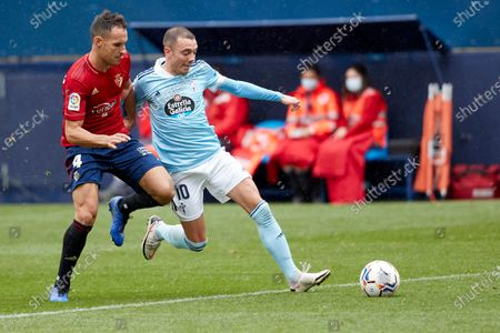 Unai Garcia (defender; CA Osasuna) and Iago Aspas (forward; RC Celta)  in action during the Spanish La Liga Santander match between CA Osasuna and RC Celta at the Sadar stadium. (Final score: CA Osasuna 2-0 RC Celta de Vigo)