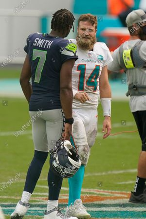 Miami Dolphins quarterback Ryan Fitzpatrick (14) talks to Seattle Seahawks quarterback Geno Smith (7), at the end of an NFL football game, in Miami Gardens, Fla. The Seahawks defeated the Dolphins 31-23