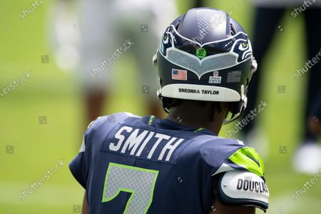 Seattle Seahawks quarterback Geno Smith (7) wears a Breonna Taylor social justice decal on his helmet on the field before taking on the Miami Dolphins during an NFL football game, in Miami Gardens, Fla