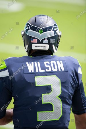 Stock Image of Seattle Seahawks quarterback Russell Wilson (3) wears a Breonna Taylor social justice decal on his helmet on the field before taking on the Miami Dolphins during an NFL football game, in Miami Gardens, Fla