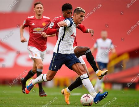 Tottenham's Erik Lamela (R) in action against Manchester United's Marcus Rashford (L) during the English Premier League match between Manchester United and Tottenham Hotspur in Manchester, Britain, 04 October 2020.