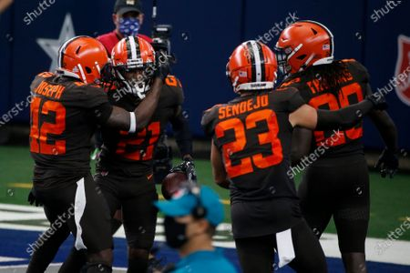 Cleveland Browns' Karl Joseph (42), Denzel Ward (21), Andrew Sendejo (23) and Tavierre Thomas (20) celebrate an interception by Ward late in the second half of an NFL football game against the Dallas Cowboys in Arlington, Texas
