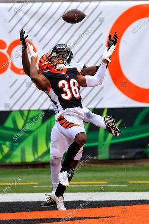 Stock Photo of Cincinnati Bengals cornerback LeShaun Sims (38) breaks up a pass intended for Jacksonville Jaguars wide receiver Chris Conley (18) in the second half of an NFL football game in Cincinnati
