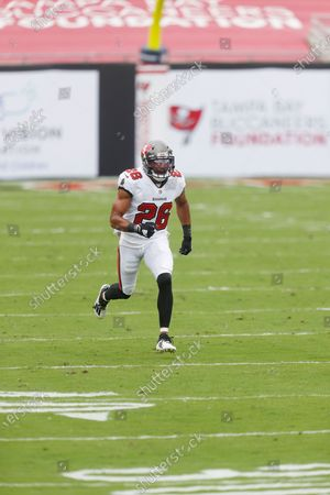 Stock Picture of Tampa Bay Buccaneers defensive back Andrew Adams (26) looks to make a defensive stop against the Los Angeles Chargers during the first half of an NFL football game, in Tampa, Fla