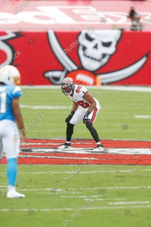 Tampa Bay Buccaneers defensive back Andrew Adams (26) looks to make a defensive stop against the Los Angeles Chargers during the first half of an NFL football game, in Tampa, Fla