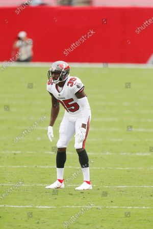 Tampa Bay Buccaneers cornerback Jamel Dean (35) looks to make a defensive play against the Los Angeles Chargers during the second half of an NFL football game, in Tampa, Fla