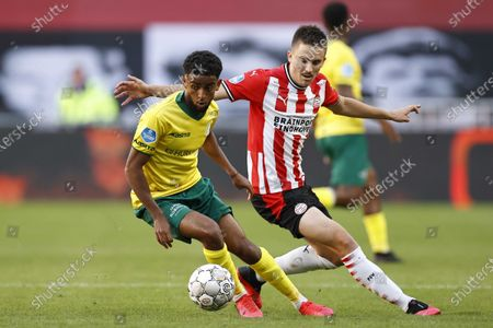 Tesfaldet Tekie (L) of Fortuna Sittard and Ryan Thomas or PSV Eindhoven in action during the Dutch Eredivisie soccer match between PSV Eindhoven and Fortuna Sittard at the Phillips stadium in Eindhoven, Netherlands, 04 October 2020.