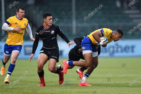 Anthony Watson of Bath Rugby takes on the Saracens defence